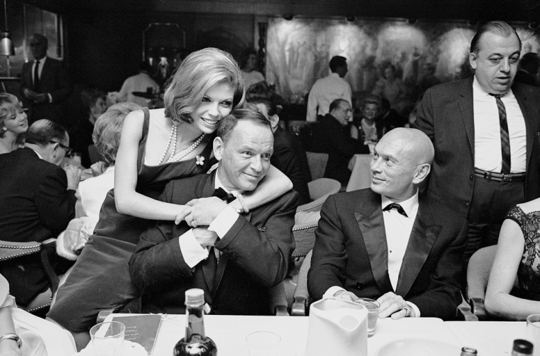 Entertainer Frank Sinatra (C) getting affectionate